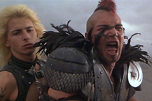 Wez (Vernon Wells in Mad Max) yelling, and Golden Youth