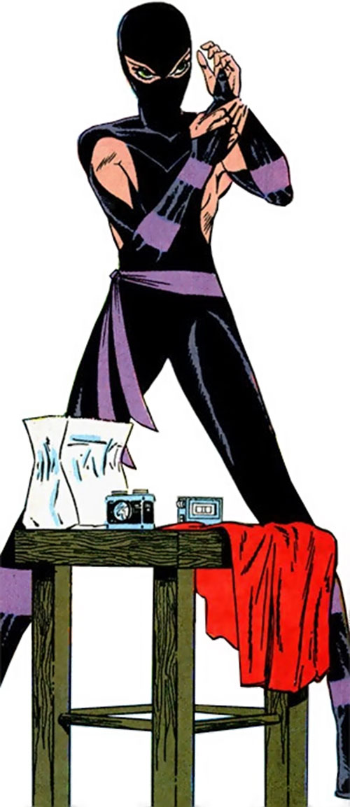 Whisper (First Comics) preparing her gear