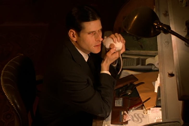 Willard (2003 rat movie with Crispin Glover) at his desk holding his white rat