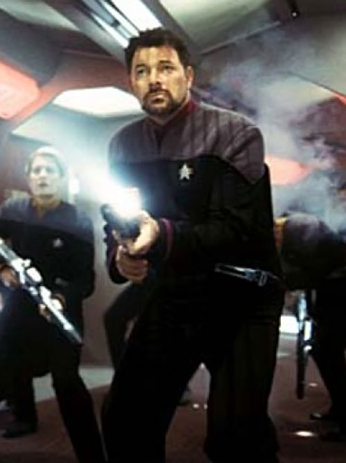 William Riker (Jonathan Frakes in Star Trek) firing a phaser rifle