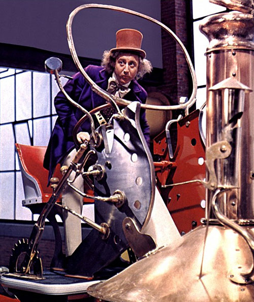 Gene Wilder as Willy Wonka, riding a strange contraption