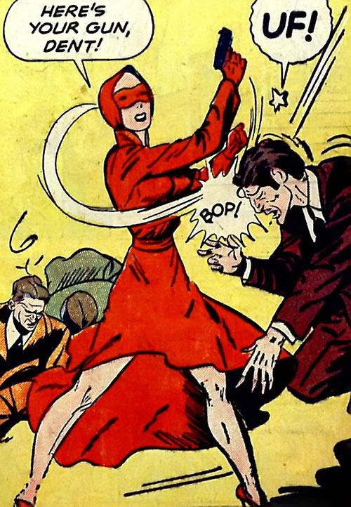 Woman in Red (Golden Age Comics) pistol-whipping a criminal