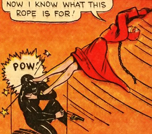 Woman in Red (Golden Age Comics) swinging and kicking