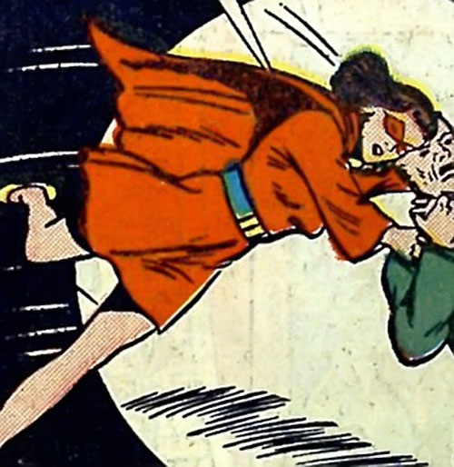 Woman in Red (Golden Age Comics) fighting in her 1943 costume