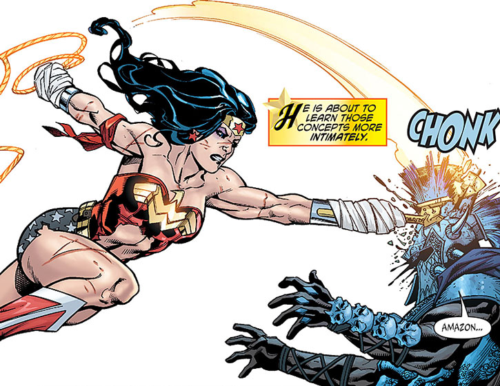 A wounded Wonder Woman hits Ares with an axe