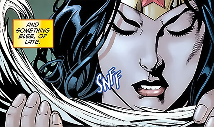 Wonder Woman sniffs a feather