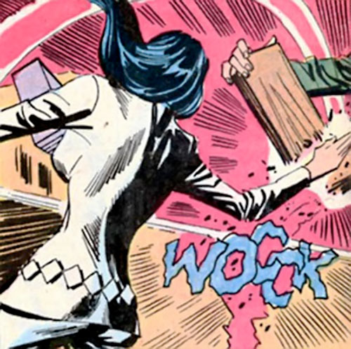 Wonder Woman Diana Prince (Karate mod era) (DC Comics) breaks a board in two