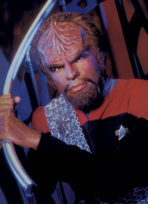 Worf (Michael Dorn in Star Trek) brandishing a Klingon weapon