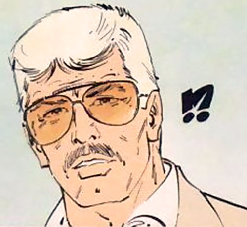 XIII with blond hair and tinted glasses
