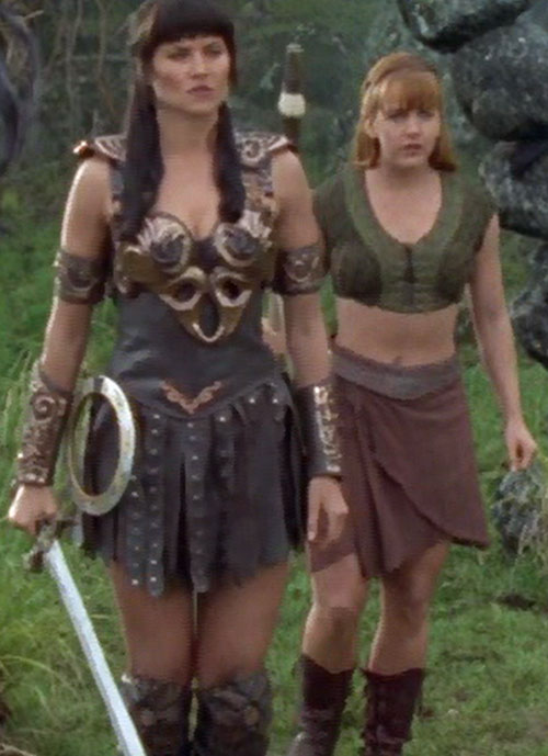 Xena (Lucy Lawless) with a sword and Gabrielle