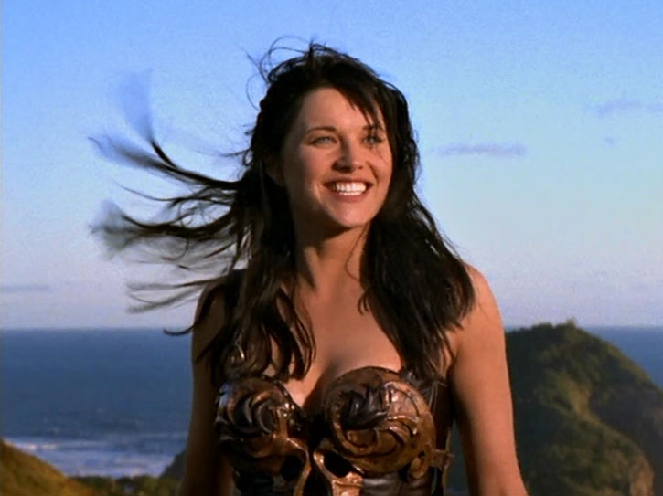 Xena (Lucy Lawless) with a big smile