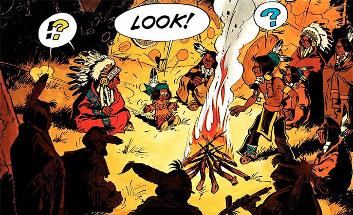 Yakari and his tribe around a campfire