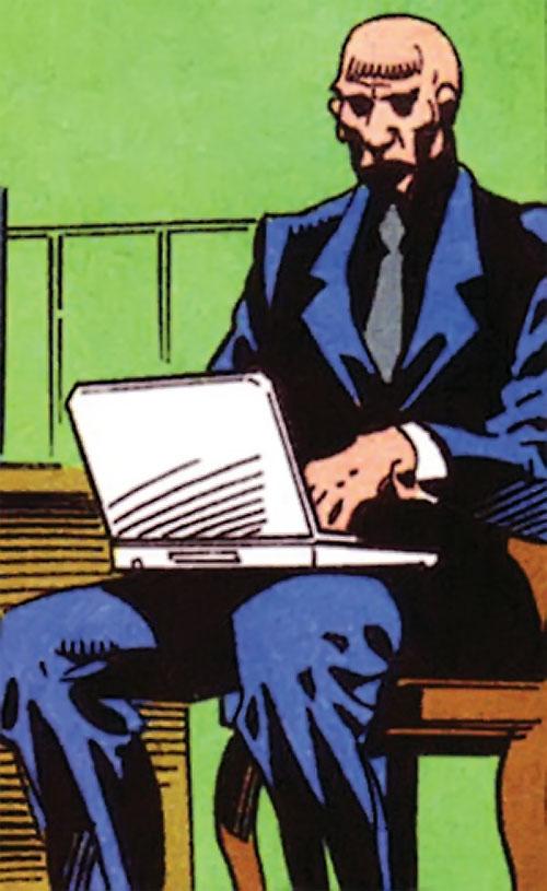 Zombie (Bane / Batman character) (DC Comics) working on a laptop